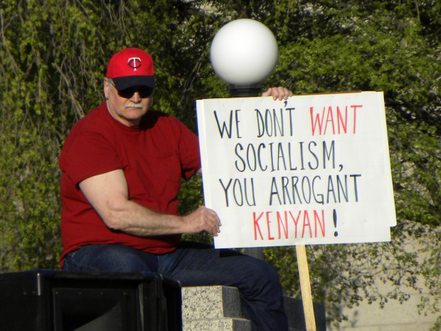 Tea Party protester with sign: 'We don't WANT socialism, you arrogant KENYAN!'